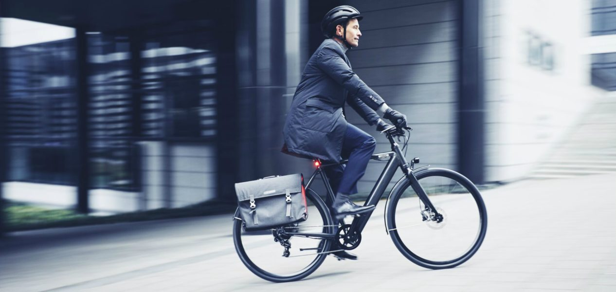 This is the image of a man riding an e-bike
